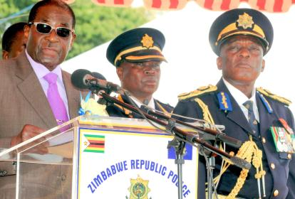 Zimbabwean President Robert Mugabe with his Police Chief Mr. Augustine Chihuri during SARPCCO meeting.